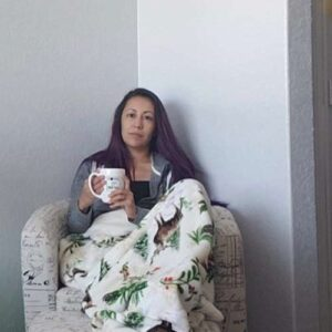 Deana likes to relax with a cup of coffee